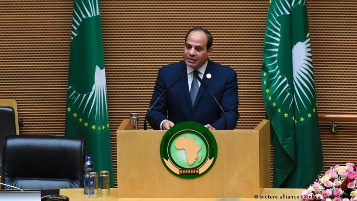 African Union chair, Egyptian President Abeba Abdel Fattah al-Sisi, stand at a podium and speaks during the closing of the African Union summit