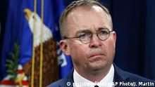 FILE- In this July 11, 2018, file photo Mick Mulvaney, acting director of the Consumer Financial Protection Bureau (CFPB), and Director of the Office of Management, listens during a news conference at the Department of Justice in Washington. White House Acting Chief of Staff Mick Mulvaney isn't setting any lofty goals for this weekend's meeting with a bipartisan mix of legislators at Camp David, but he is trying to build relationships across the aisle. (AP Photo/Jacquelyn Martin, File) |