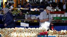 People buy vegetables at a bazaar in Ankara, Turkey August 16, 2018. REUTERS/Umit Bektas
