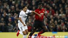 Manchester United v Paris Saint-Germain - UEFA Champions League - Round of 16 - First Leg - Old Trafford. Paris Saint-Germain's Marquinhos and Manchester United's Paul Pogba battle for the ball during the UEFA Champions League round of 16, first leg match at Old Trafford, Manchester. Picture date: Tuesday February 12, 2019. See PA story SOCCER Man Utd. Photo credit should read: Martin Rickett/PA Wire URN:41176207 |