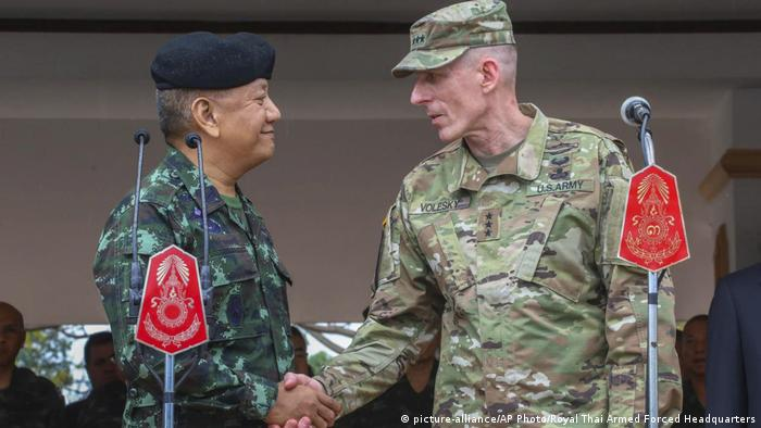 Royal Thai Armed Forces General Pornpipat Benyasri shakes hands with Commander Lieutenant General Gary J. Volesky during the opening ceremony of the Cobra Gold military exercise