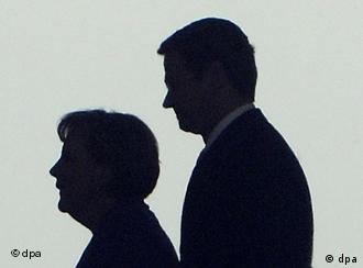 The shadow of Vice Chancellor Guido Westerwelle and Chancellor Angela Merkel