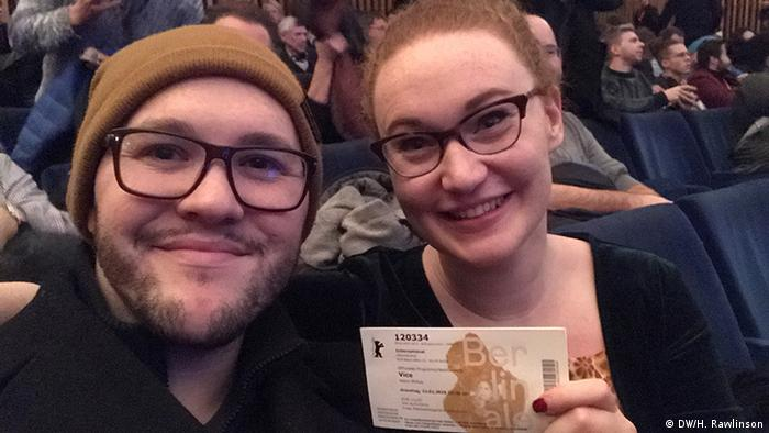 Hallie and her partner with tickets for the movie VICE