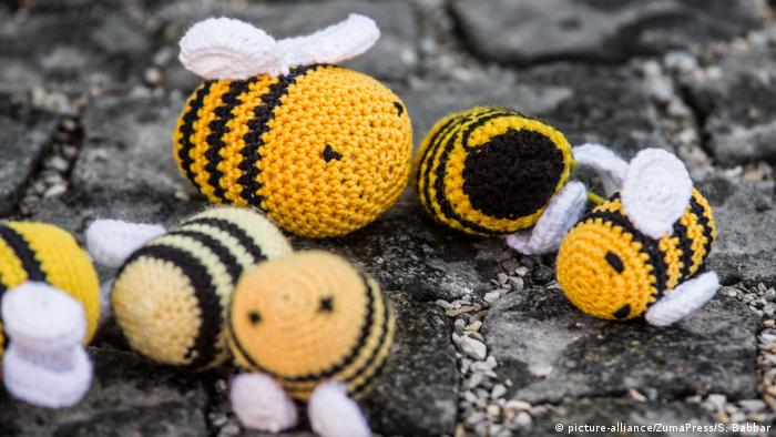 Stuffed animal bees in disarray on the ground