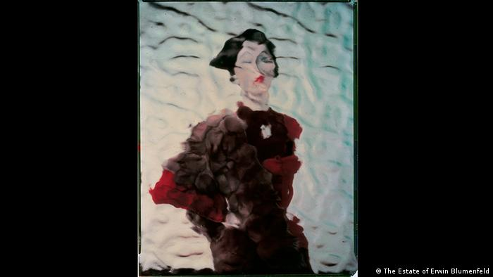 Erwin Blumenfeld exhibition. Model: Dovima, in black and red, photographed through lavatory glass. Variant of photo in Vogue US, August 1, 1950. (The Estate of Erwin Blumenfeld)