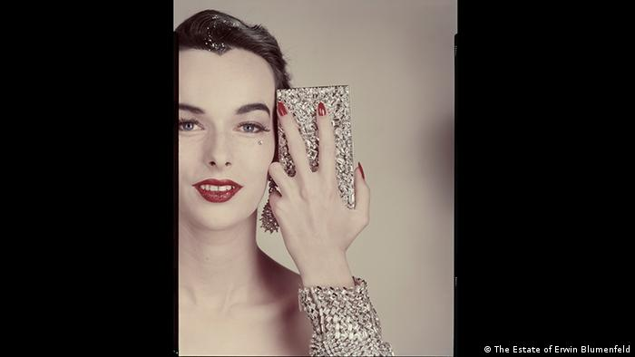 Minaudiere Evans. Portrait shot of dark-haired woman with red lips and heavy metal jewellery. Variant of photo published in the article 'The Same Face' in Vogue US, October 15,1952. Earrings Ledo, bracelet Henri Bendel. Erwin Blumenfeld exhibition, Foam, Amsterdam (The Estate of Erwin Blumenfeld)