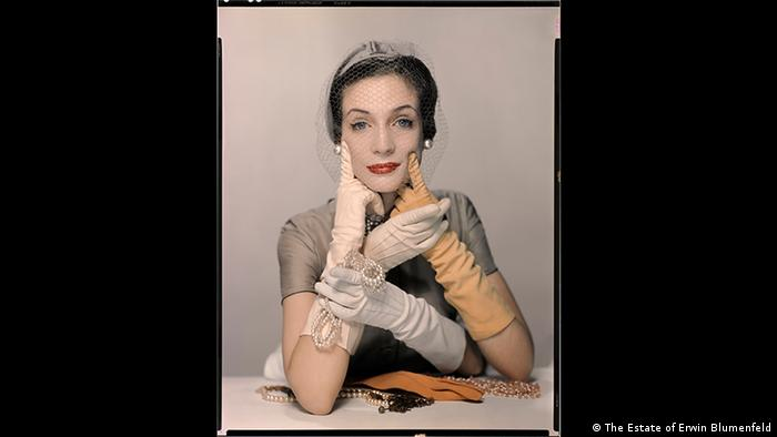 Erwin Blumenfeld exhibition, Foam, Amsterdam. A model is photographed wearing long gloves and jewellery, in a way that makes her look like she has four hands. Pat Blake for Vogue NY 1954 (The Estate of Erwin Blumenfeld)