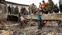 Indonesian soldiers and rescue workers search for earthquake victims trapped under a destroyed building in Padang, West Sumatra, Indonesia, Thursday, Oct. 1, 2009. A second earthquake with a 6.8 magnitude rocked western Indonesia Thursday, a day after the region was devastated by an undersea quake of 7.6 magnitude. (AP Photo/Achmad Ibrahim)