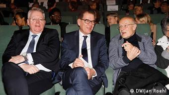 three men in front row seats, DW director Peter Limbourg, Development Minister Gerd Müller and Volker Schlöndorff