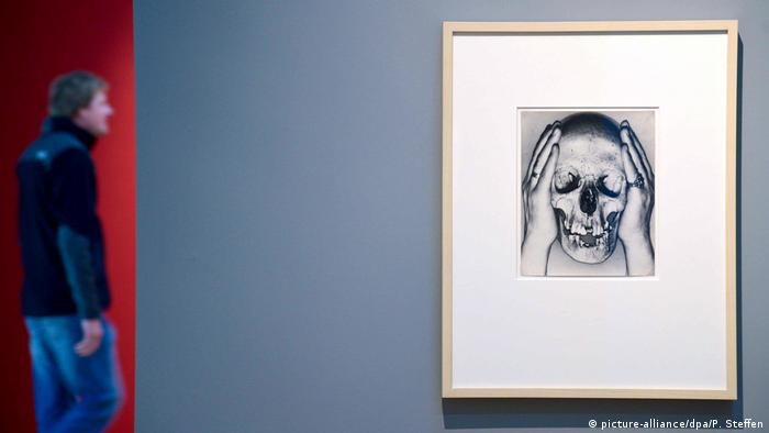 The photograph death skull by Erwin Blumenfeld hands on a wall