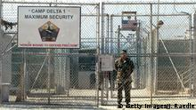 GUANTANAMO BAY, CUBA - APRIL 7: A U.S. Army soldier stands at the entrance to Camp Delta where detainees from the U.S. war in Afghanistan live April 7, 2004 in Guantanamo Bay, Cuba. On April 20, the U.S. Supreme Court is expected to consider whether the detainees can ask U.S. courts to review their cases. Approximately 600 prisoners from the U.S. war in Afghanistan remain in detention. (Photo by Joe Raedle/Getty Images)