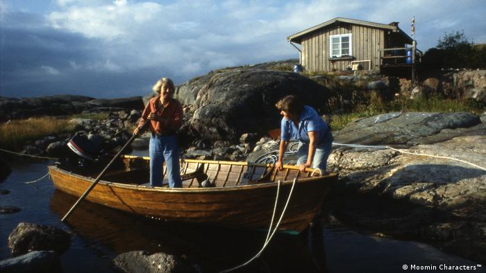 Tove Jansson in a wooden boat (Moomin Characters™)