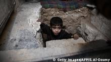 A child in a concrete shelter (Getty Images/AFP/S. Al-Doumy)