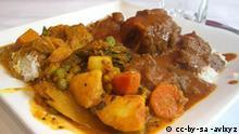 Gericht mit Fleisch und Kürbiss