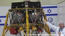 Opher Doron, general manager of Israel Aerospace Industries' space division, speaks beside the SpaceIL lunar module, in a special clean room where the space craft is being developed, during a press tour of their facility near Tel Aviv, Israel, Tuesday, July 10, 2018. SpaceIL and the state-owned Israel Aerospace Industries plan to launch their unmanned craft in December hoping to become the first non-governmental entity to land a spacecraft on the moon. (AP Photo/Ilan Ben Zion) |