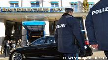 Police walks past the main entrance of the Bayerischer Hof hotel in Munich, southern Germany, on February 15, 2019, where the 55th Munich Security Conference (MSC) takes place. - The 2019 edition of the Munich Security Conference (MSC) will take place from February 15 to 17, 2019. (Photo by THOMAS KIENZLE / AFP) (Photo credit should read THOMAS KIENZLE/AFP/Getty Images)