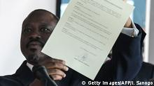 Speaker of the Ivorian National Assembly Guillaume Soro hold up a document during the launch of a new movement called 'Political Committee', one week after his resignation as speaker on February 15, 2019 in Abidjan. - Soro is a member of Ivory Coast's President Alassane Ouattara's Rally of Republicans (RDR) party but is rumoured to have fallen out with him. Ouattara nonetheless said there was no problem between them, adding: I do not rule out that he will return. (Photo by ISSOUF SANOGO / AFP) (Photo credit should read ISSOUF SANOGO/AFP/Getty Images)