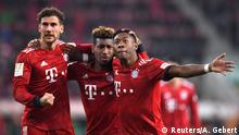 Soccer Football - Bundesliga - FC Augsburg v Bayern Munich - WWK Arena, Augsburg, Germany - February 15, 2019 Bayern Munich's David Alaba celebrates scoring their third goal with Kingsley Coman and Leon Goretzka REUTERS/Andreas Gebert DFL regulations prohibit any use of photographs as image sequences and/or quasi-video