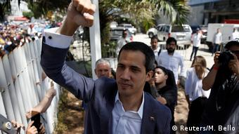 (Reuters/M. Bello) Guido raises his fist as he walks down the street with supporters behind him