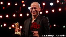 Nadav Lapid shows Golden Bear for Best Film after the awards ceremony at the 69th Berlinale International Film Festival in Berlin, Germany, February 16, 2019. REUTERS/Hannibal Hanschke