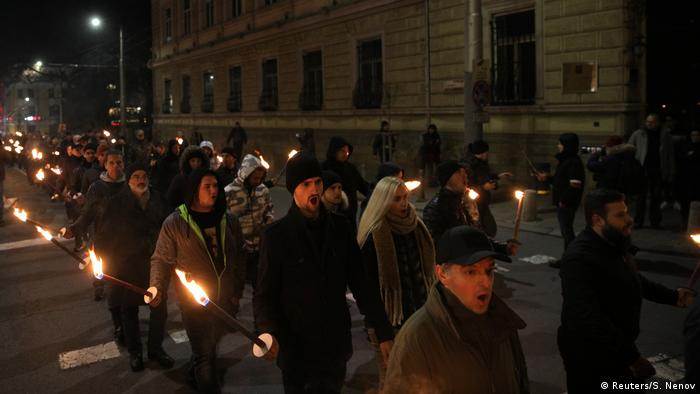 Torch-carrying protesters march in Sofia