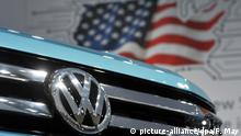 Volkswagen car in front of US flag