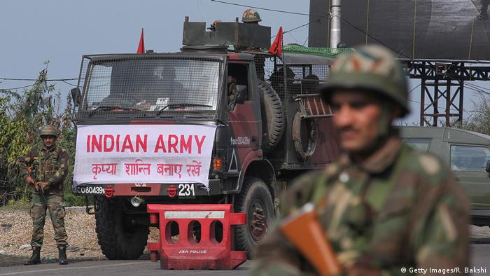 An Indian army soldier stands guard during a curfew in Jammu