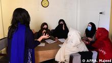 17.12.2018 In this picture taken on December 17, 2018, Ayeesha (L), an employee of the Pakistani NGO Aware Girls, briefs other employees on how to treat and answer calls on the hotline Sahailee (friend in Urdu) dedicated to abortion in Peshawar. - More than two million women a year have secret abortions in Pakistan, a country where pressure from religious leaders critical of family planning measures and a lack of sex education often results in unwanted pregnancies. (Photo by ABDUL MAJEED / AFP) / TO GO WITH Pakistan-abortion-women-religion-health-gender,FEATURE by Lehaz ALI and Joris FIORITI