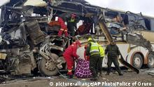 In this photo released by the Bolivian Police of Oruro, firefighters and police help a victim of a crash of two buses on the outskirts of Challapata, Bolivia, Saturday, Jan. 19, 2019. The crash killed dozens of people and left several injured on a road in the Bolivian highlands, police said. (AP Photo/ Bolivian Police of Oruro via AP) |