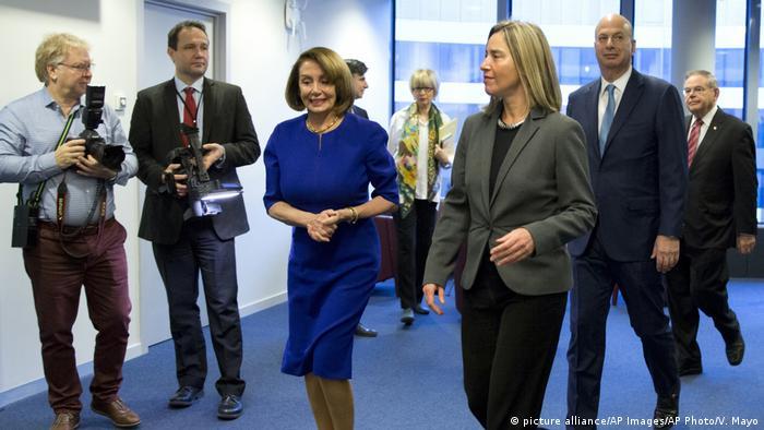Pelosi walks with Mogherini
