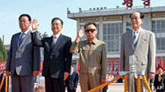 Chinese Premier Wen Jiabao, second left, stands with North Korean leader Kim Jong Il, second right