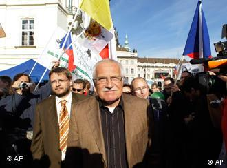 Czech President Vaclav Klaus stands among reporters and demonstrators at an anti-EU rally in Prague