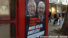 """A phone box displays a billboards showing Hungarian-American financier George Soros and EU Commission President Jean-Claude Juncker above the caption """"You have a right to know what Brussels is preparing to do!, on Vaci Avenue in Budapest, Hungary, Tuesday, Feb. 19, 2019. The Hungarian government has launched a new campaign targeting what it claims are efforts by the European Union leadership to organize mass migration into Europe, mainly by Muslims. (AP Photo/Pablo Gorondi) 