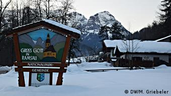 Village entrance sign of Ramsau in winter