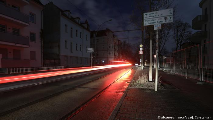 Berlin city street in darkness with just tailights of cars showing