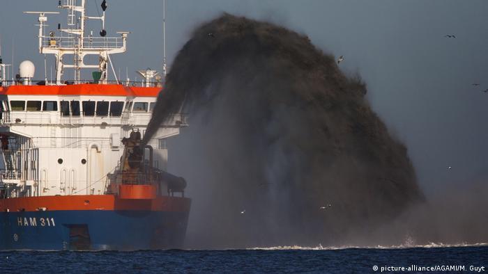 A large ship pumping sand onto coastal areas in the Netherlands