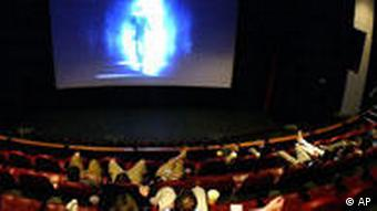 An audience sits in a movie theater