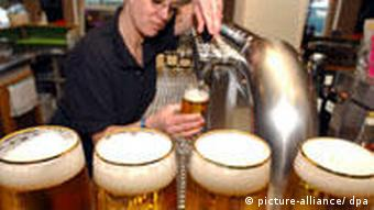 Barmaid pulling pints of beer