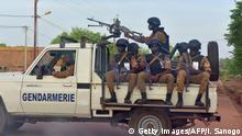 A picture take on October 30, 2018 shows Burkinabe gendarmes sitting on their vehicle in the city of Ouhigouya in the north of the country. - Two Burkinabe soldiers were killed and three wounded in the night of November 5, 2018 in Nassoumbou, northern Burkina Faso, near the Malian border, by the explosion of an improvised explosive device, according to security sources. (Photo by ISSOUF SANOGO / AFP) (Photo credit should read ISSOUF SANOGO/AFP/Getty Images)