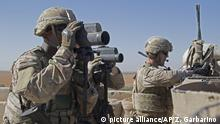 In this Nov. 1, 2018, photo released by the U.S. Army, soldiers surveil the area during a combined joint patrol in Manbij, Syria. The United States' main ally in Syria on Thursday, Dec. 20, 2018, rejected President Donald Trump's claim that Islamic State militants have been defeated and warned that the withdrawal of American troops would lead to a resurgence of the extremist group. (U.S. Army photo by Spc. Zoe Garbarino via AP) |