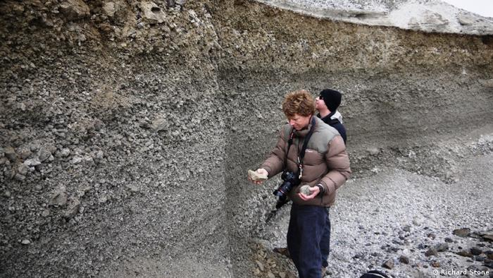 British researchers James Hammond and Clive Oppenheimer inspect ash layers from Mount Paektu volcanic eruption (Richard Stone)