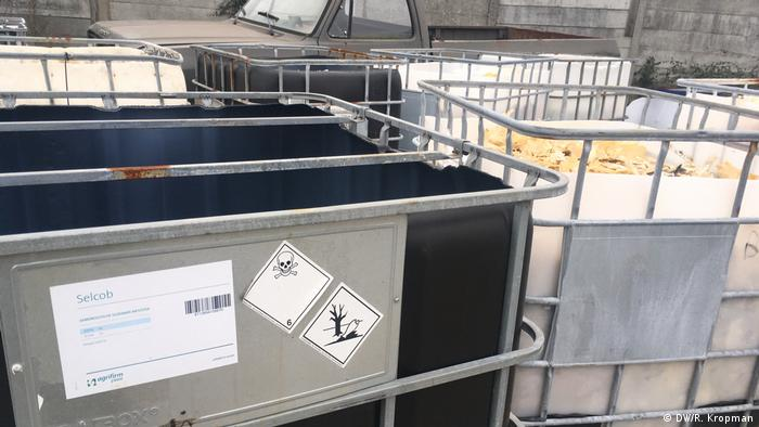 Jerry cans with chemicals ground to shrapnel