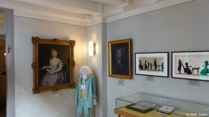 A life-sized puppet, silouhettes and documents