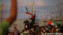 October 8, 2018 - Dozens of Palestinian demonstrators are injured by Israeli live ammunition and tear gas during clashes with Israeli military forces along the northern Gaza Strip near the beach of Zakim. Some Palestinian protesters burned tyres and threw rocks towards the Israeli troops on the other side of the fence, and according to the Israeli army some explosive devices were also hurled in the direction of the fence. Protesters were calling for the lift of the air, land and water blockade imposed by Israel on the Palestinian enclave since 2007 when Hamas took power in Gaza after winning the elections. Israel maintains that the blockade, which has also been enforced by Egypt, is a necessary measure to prevent Hamas and other militant groups in Gaza to arm or build military infrastructure. Yet, the World Bank has openly stated that Gaza's economy is on the brink of collapse with the blockade playing a big part in that |