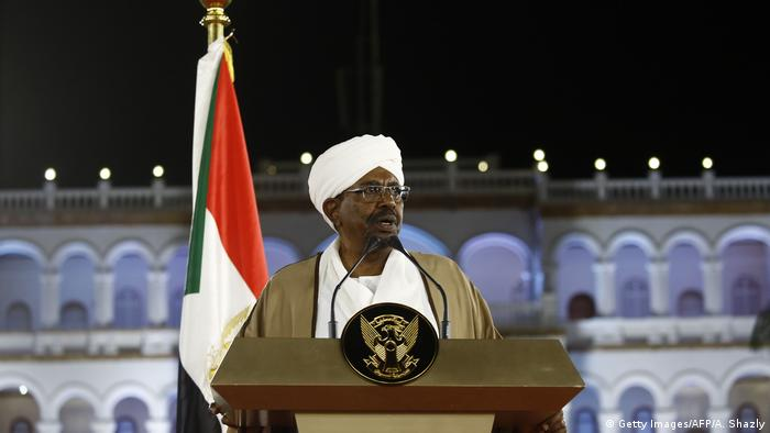 Former Sudanese President Omar al-Bashir delivers a speech in front of the presidential palace
