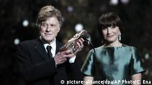 Actor and director Robert Redford, left, receives an honorary Cesar award from actress Kristin Scott Thomas during the 44th Cesar Film Awards ceremony, in Paris, Friday, Feb 22, 2019. (AP Photo/Christophe Ena) |