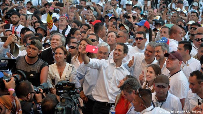 Хуан Гуайдо, а также президенты Чили и Колумбии Себастьян Пинера и Иван Дуке на концерте в поддержку Венесуэлы