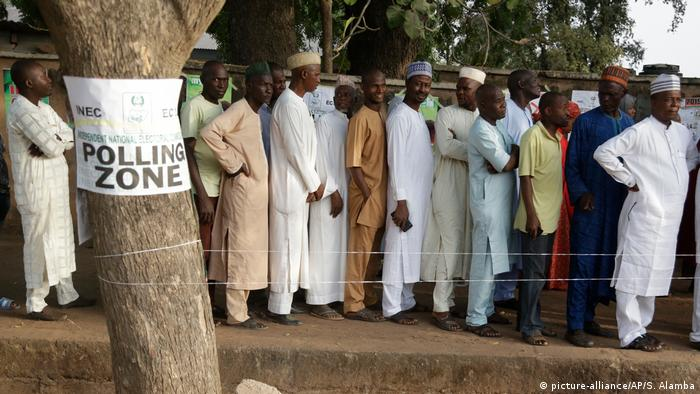 Men line up to cast their votes in the Nigerian election