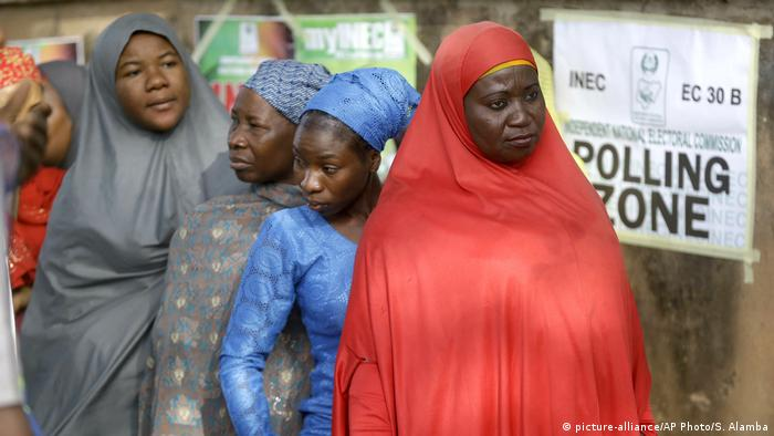 Women waiting in line to cast their vote