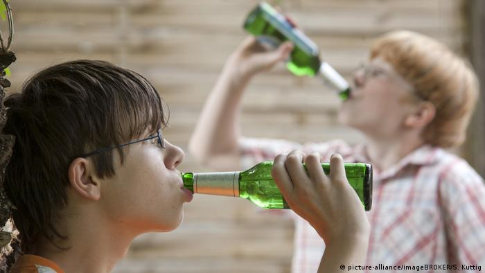 Two German boys drink alcohol